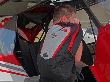CubCrafters red plane logo backpack